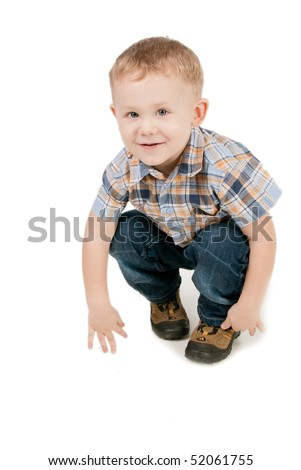 Portrait of the two-year blue-eyed boy in a chequered shirt, isolated on white