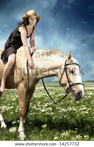 Portrait Of The Woman Feeding Her Horse With Grass Stock Photo ...