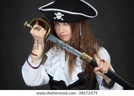Portrait of the woman in a pirate hat with a sabre in hands