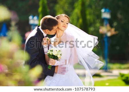 Portrait of the young beautiful bride and groom on the nature