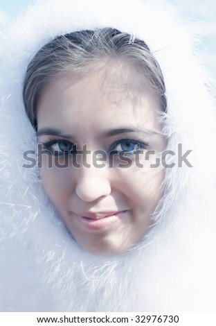 Portrait of the young beautiful girl in a white boa