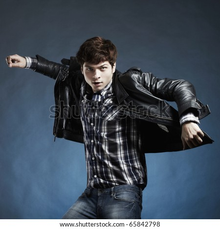 Portrait of the young beautiful man in a jump - stock photo