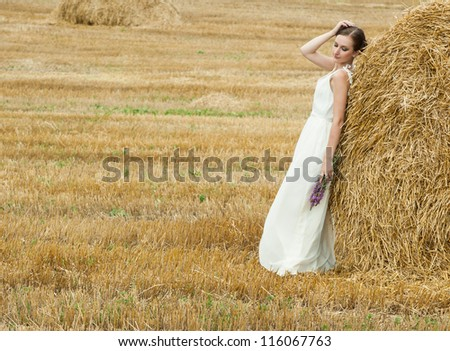 Portrait of the young beautiful smiling woman outdoors #116067763