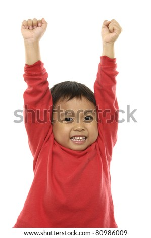 Portrait of the young boy holding hands up,