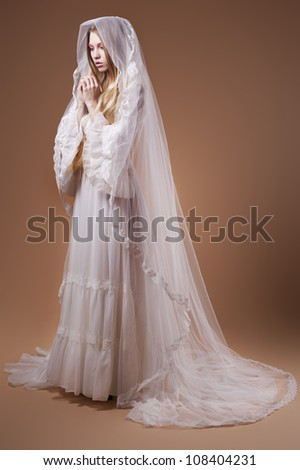 Portrait of the young bride in studio