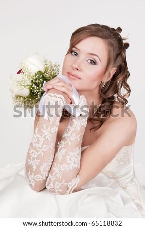 Portrait of the young bride in studio