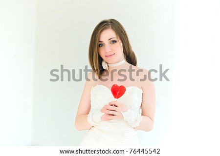 Portrait of the young bride with a candy