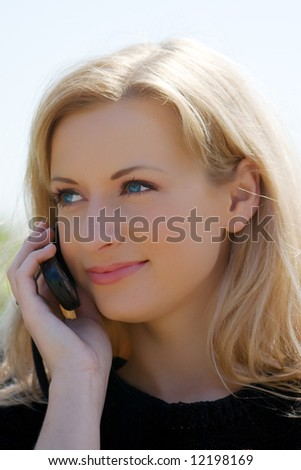 Portrait of the young girl speaking by phone