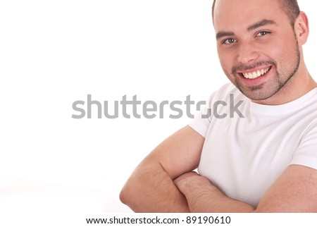 Portrait of the young happy smiling man isolated on a white background