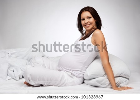 Portrait of the young pregnant girl