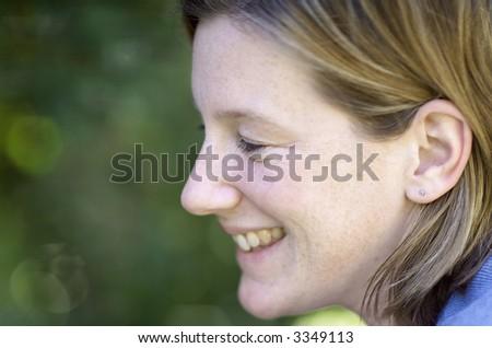Portrait of thirty something female outdoors