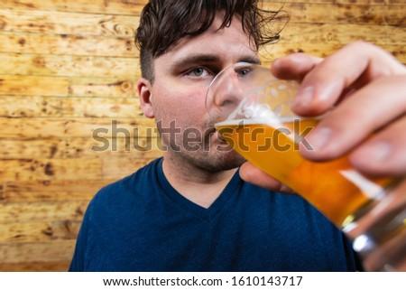 Portrait of thoughtful men drinking beer. Men drinking beer. Handsome young men drinking beer and dreaming away.