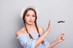 Portrait of thoughtful minded attractive nice lady hold hand expression pensive refusal protection wrong she dont do stop dressed her plaid off-shoulder clothing isolated grey background