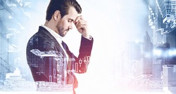Portrait of thoughtful young businessman standing in blurry city. Concept of decision taking and brainstorming. Toned image double exposure
