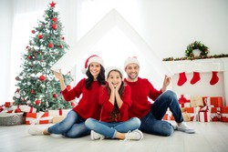 Portrait of three attractive lovely cheerful cheery glad excited careful family celebrating newyear loan purchase real estate credit move relocation in light white interior living-room