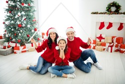 Portrait of three attractive lovely cheerful cheery glad excited delighted family celebrating newyear loan purchase real estate credit buying apartment owners in light white interior living-room