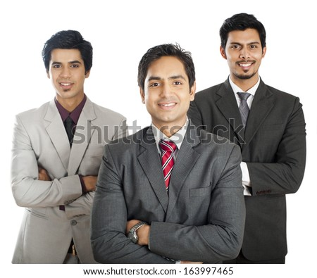 Portrait of three businessmen standing with their arms crossed and smiling Photo stock ©