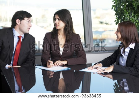 Portrait of three businesspeople interacting at meeting