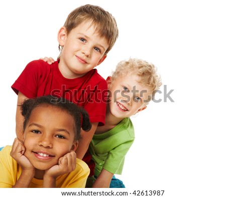 Portrait of three children looking at camera over white background
