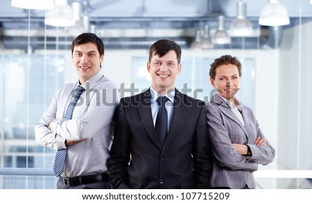 Portrait of three confident business people working as a successful team