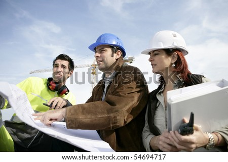 Portrait of three entrepreneurs on a construction site