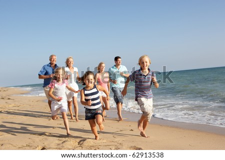 Portrait Of Three Generation Family On Beach Holiday