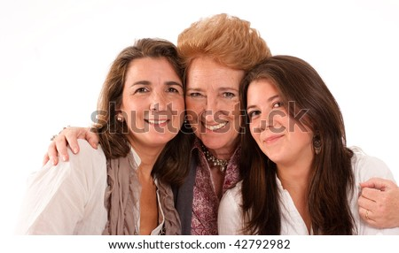 Portrait of Three generations of women of the same family isolated in white