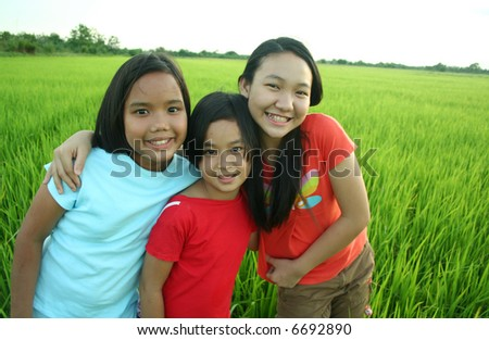 Portrait of three girls in the rice field.