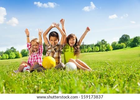 portrait of three happy kids ...