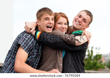 Portrait of three happy young teenagers