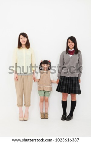 Portrait of three japanese sisters #1023616387