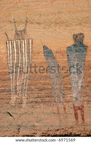 portrait of three pictograph figures in cayonlands national park