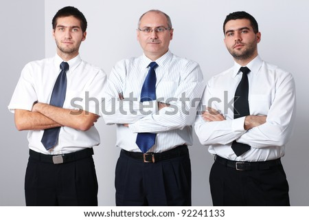 Portrait of three serious businessman with crossed arms