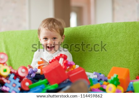 Portrait of  three-year child in home interior