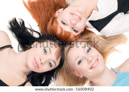 Portrait of three young cheerful women on white background