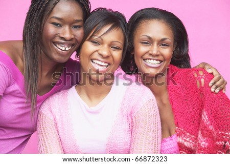 Portrait of three young women smiling - stock photo