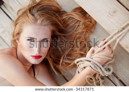 Portrait of tied up beautiful girl - stock photo