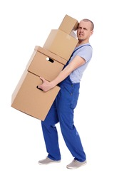 portrait of tired man loader in uniform with heap of boxes isolated on white background