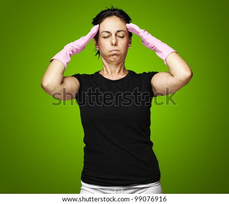 portrait of tired woman over green background