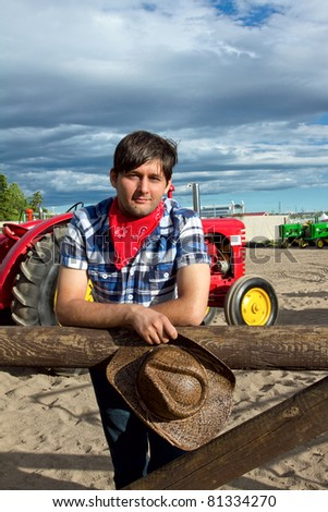 Portrait of tractor driver wearing western clothing. Photo is taken during Calgary Stampede 2011