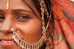 Portrait of traditional Indian woman in sari costume covered her head with veil, India people.