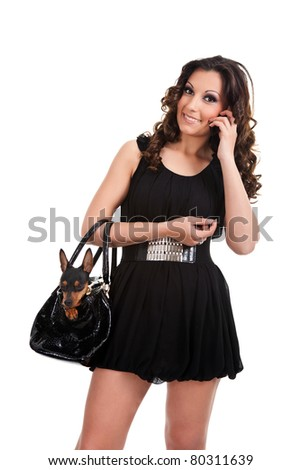 portrait of trendy woman with   miniature  pincher in bag, isolated on white background