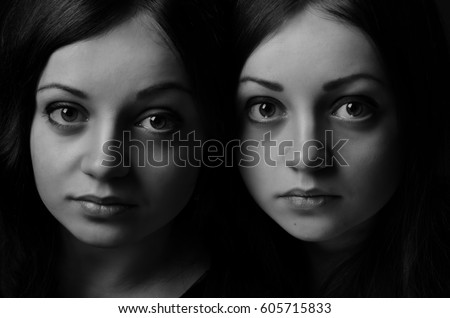 Portrait of twins. The twins. Close-up. Black and white photo