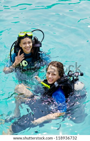 Portrait of two attractive friends going scuba diving