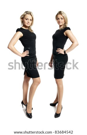 Portrait of two attractive young women in a black dress looking at camera.