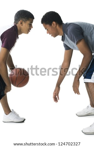Portrait of two boys playing basketball