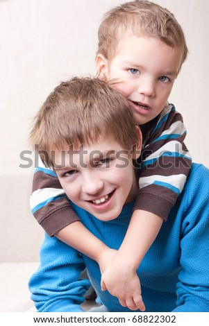 Portrait of two brothers in room - stock photo