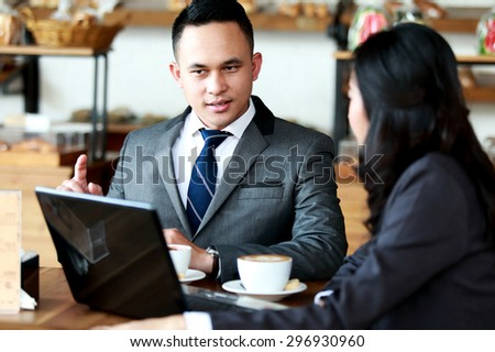 portrait of two business people meeting at coffee shop