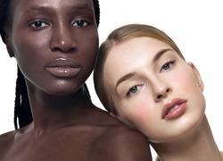 Portrait of two cheerful multiethnic women. Beautiful women, flawless skin. Diverse friends.