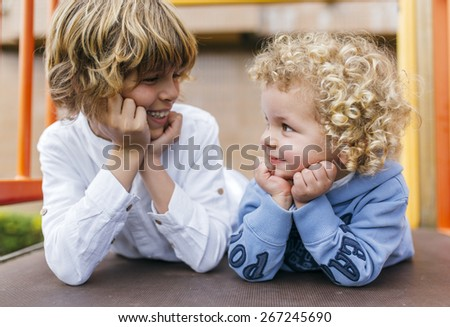 Portrait of two children blond brothers in the park